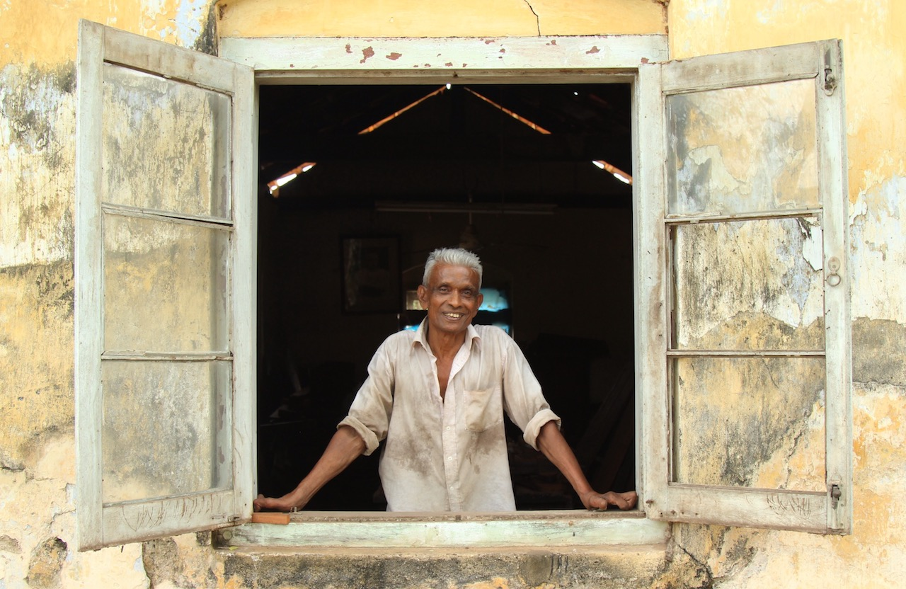Despite living with leprosy, Ananda supports himself and his family through woodworking.