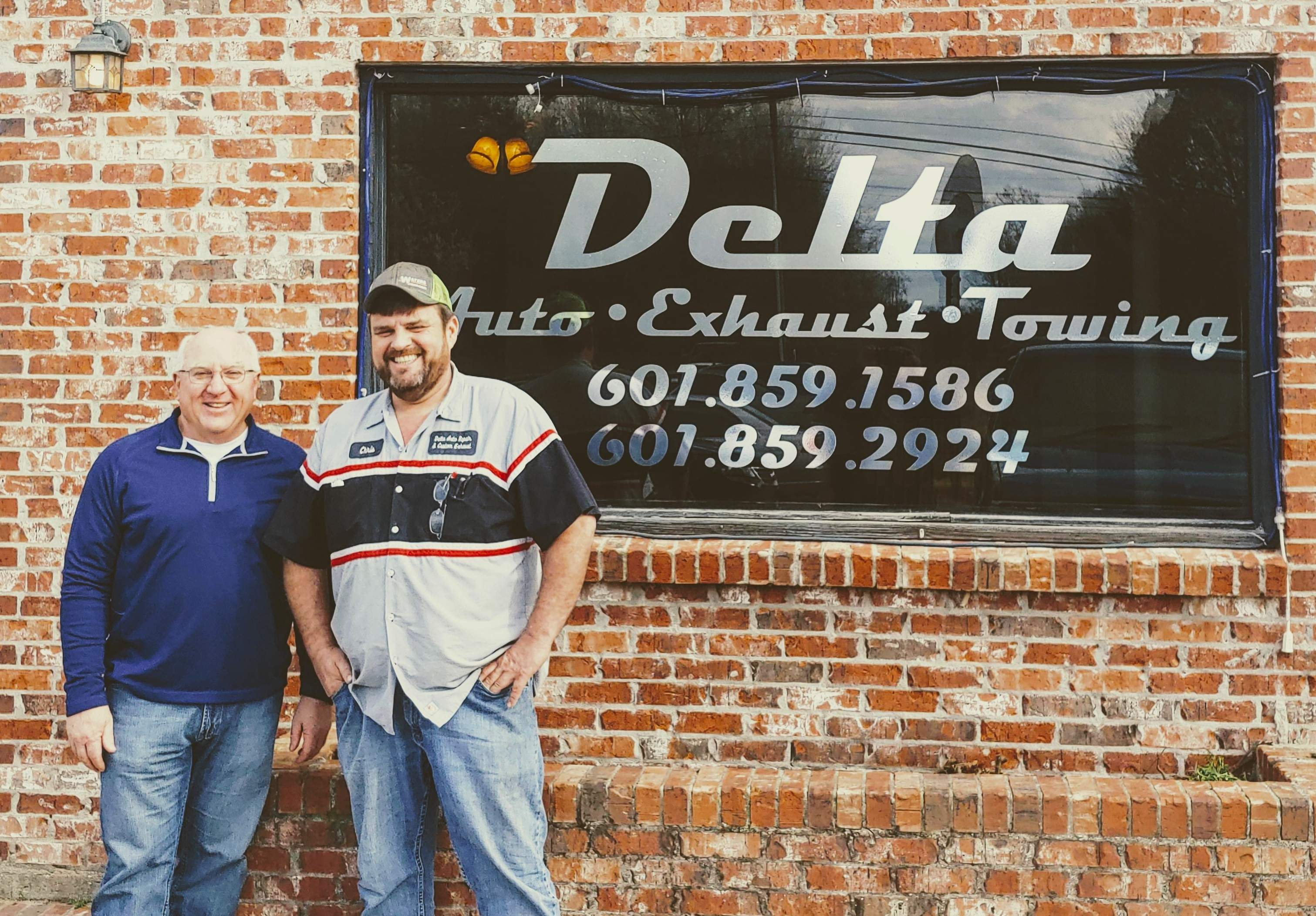 Denny and Chris in front of Chris's business in Mississippi