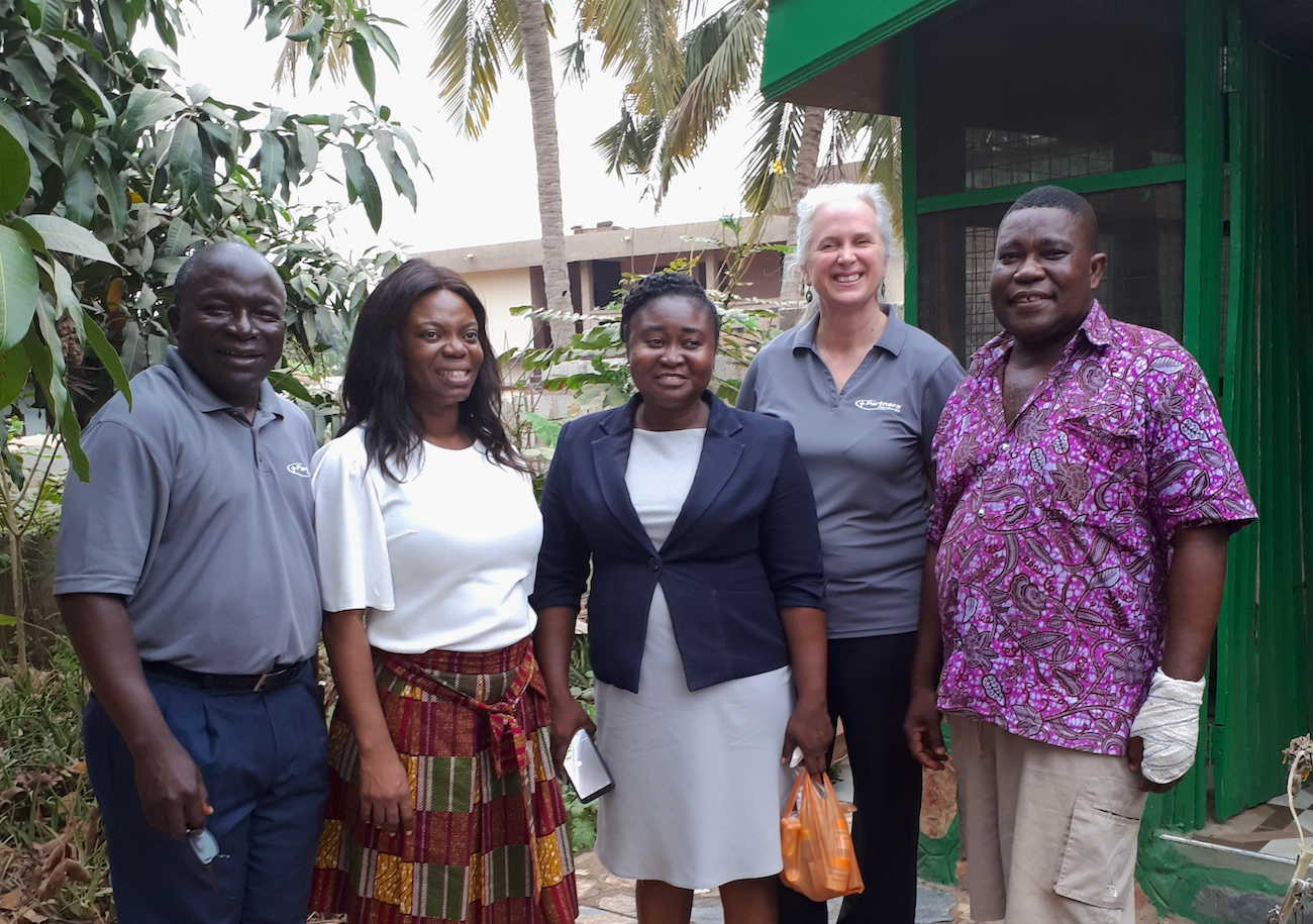 Patrick (far right) with staff from Hopeline Institute and Partners Worldwide.