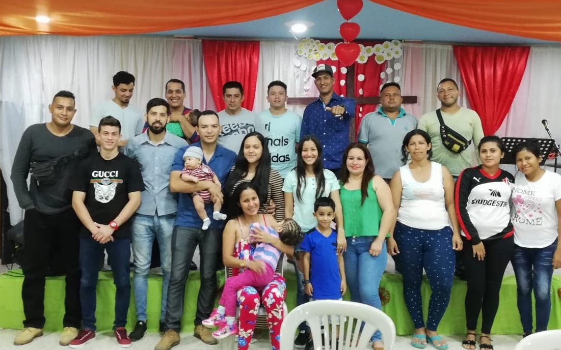 Venezeuelans who came to Ecuador as refugees pictured with members of the Partners Worldwide local network.
