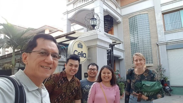 Hoi Lai Goh and Jerry Tan, left, are BA team members from Singapore, visit Celia Hostel, one of the businesses the team has mentored over the past year (December 2019).